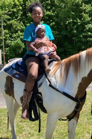Visitors to the May Day Festival enjoy pony rides.