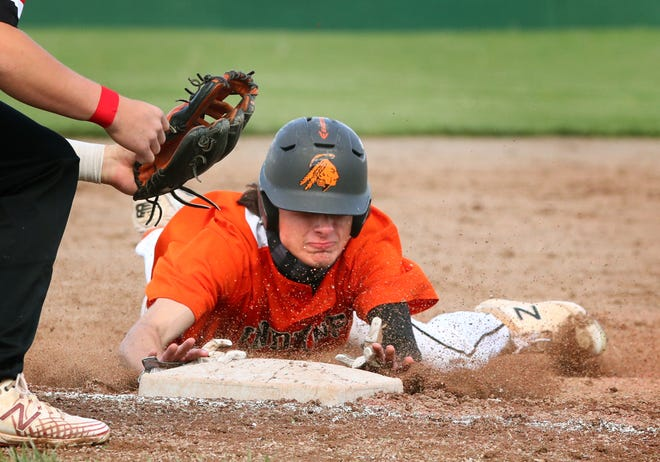 Tecumseh's Evan Andrews slides into third base during Friday's doubleheader against East Jackson.