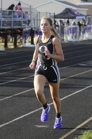 Onsted's Kara Terakedis runs in the 3,200 during a meet earlier in the 2021 season.