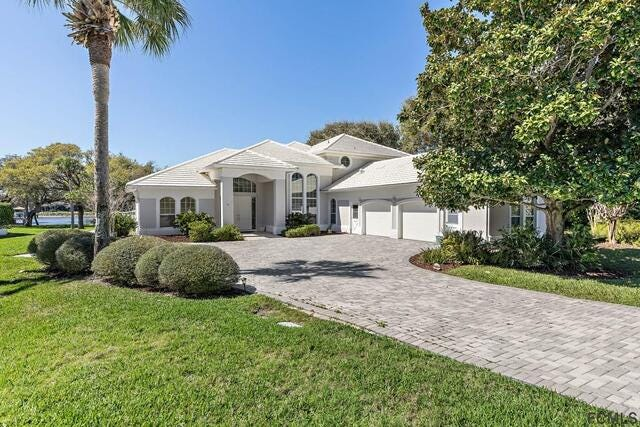This house on Island Estates Parkway, in the Hammock, sold recently for $1,326,000. It has four bedrooms and five baths in 4,158 square feet of living space, and it also has a home office, fireplace, screened pool, balcony and summer kitchen. Built in 1993 on the Intracoastal Waterway, it has a dock and covered boathouse.