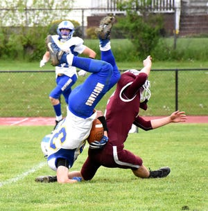 Frankfort-Schuyler tackler Jeffrey DeSarro (right) upends Mt. Markham Mustang Shawn Capes during the first half Friday.