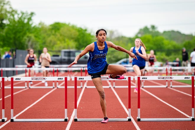 Grain Valley's JayOnna Perry clears the final hurdle on a way to a win in the 300-meter hurdles at the Suburban Middle Six Championships Friday at Fort Osage. Perry helped the Eagles dominate to win the team title.