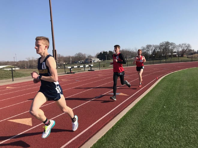 Kile Dowd (center), a freshman from Danville, competes in a race for the Southeastern Community College track and field team.