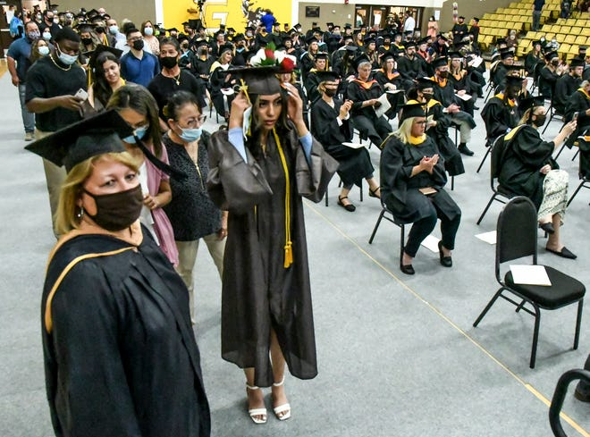 Students graduating at GCCC Friday were ushered into the gym with their families, then walked across the stage to get their diplomas and rejoin their families on the other side of the stage to be video taped getting their diplomas for the virtual presentation, then ushered out of the ceremony.