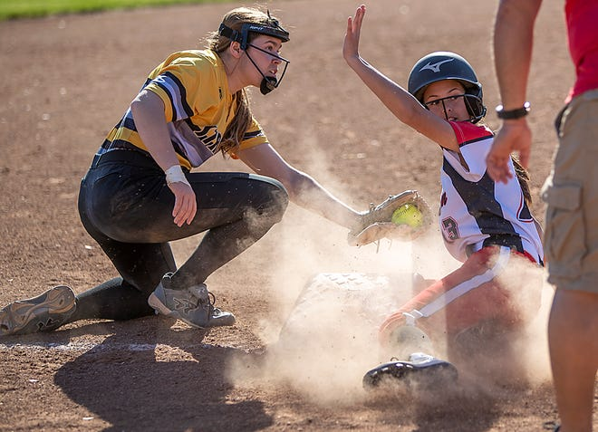 United's Addi Olmsted signals for timeout after just beating the tag by Galesburg third baseman Makayla Huff during the Red Storm's 8-4 win over the Silver Streaks on Friday, May 7, 2021 at GHS.
