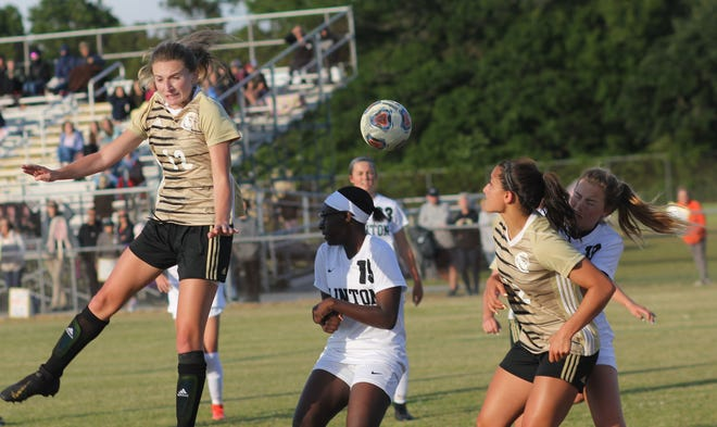 Croatan's Haley Cousins, left, heads the ball towards the net during the Cougars' 1-0 loss to Clinton on Friday in the East Regional semifinal of the NCHSAA 2-A girls' soccer playoffs. [Chris Miller / The Daily News]