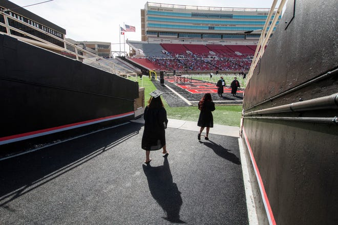 Graduates from Texas Tech's class of 2020 walk onto the field at Jones AT&T Stadium Friday evening for a special commencement ceremony.