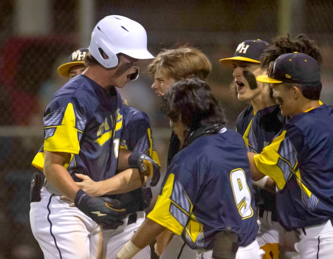 Winter Haven High School's Dylan Bowen, left, is congratulated at the plate after hitting a solo run home run against Plant City to tie the game at 2-2 during the fifth inning of their Class 6A, Region 2 quarterfinal game at Winter Haven High School Friday night.