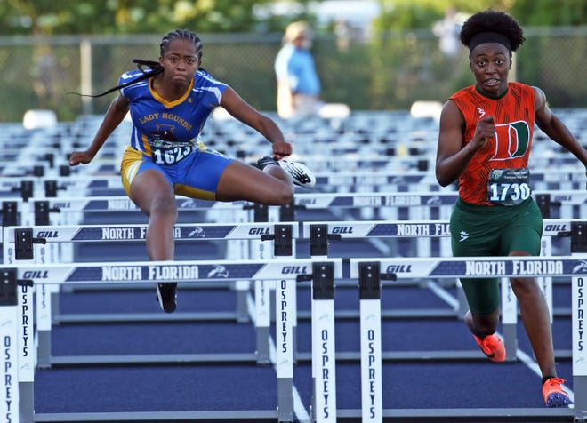Auburndale's Tyra Thomas runs to a second-place finish behind Dunbar's Lucheyona Weaver in the 100 hurdles on Friday at the Class 3A state track meet.