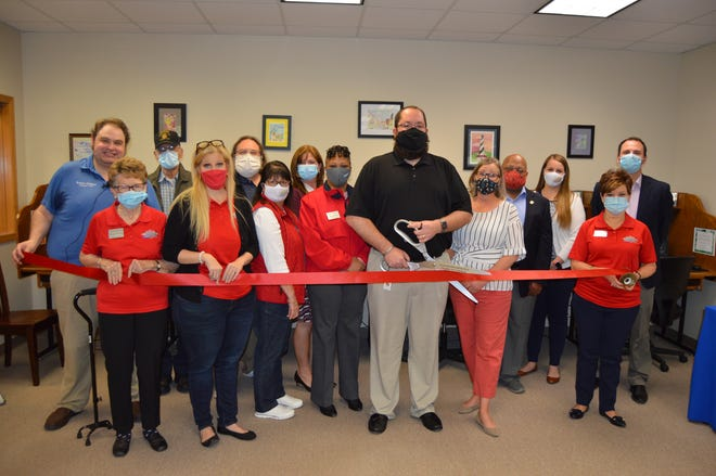 Representatives of the Leavenworth-Lansing Area Chamber of Commerce and the city of Lansing participate in a ribbon cutting Wednesday at the Lansing Community Library. The chamber has opened a satellite office at the library. The office is open from 10 a.m. to 4 p.m. each Wednesday.