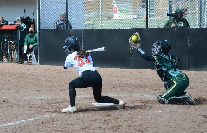 Monroe's Kara Danish takes a high pitch that is snared by St. Mary Catholic Central catcher Emma Gessner earlier this season. Danish had a key hit  and went 3-for-3 in the first game as the Trojans swept Tecumseh Wednesday.