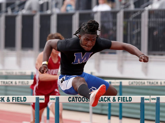 Millwood's Desmond Green competes in the 110-meter hurdles during the Class 3A state meet in Catoosa on May 7.