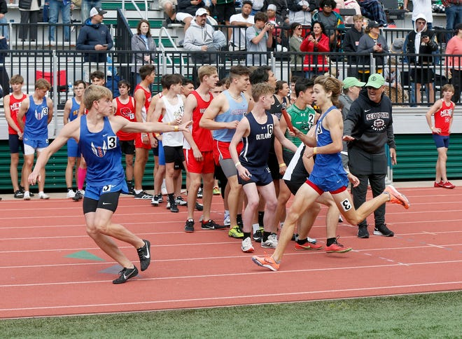 Oklahoma Christian School runner competet in the boys 4x800 meter relay at the Class 3A track and field state championship in Catoosa on Friday.
