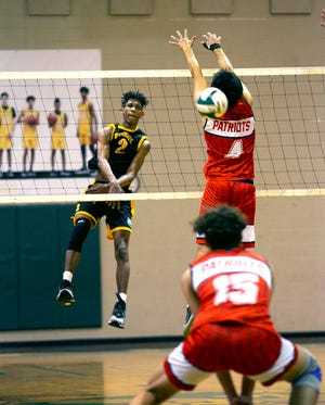 Forest's Klistan Lawrence with the kill against Lake Brantley. The Wildcats defeated the Patriots in five sets to win the region title.