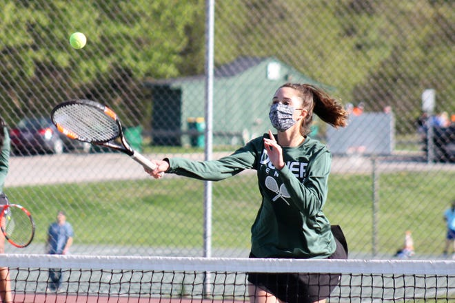 Dover High's Grace Hitchcock returns a shot at the net in doubles action during Friday's Division I match with Spaulding at the Woodman Park courts in Dover.
