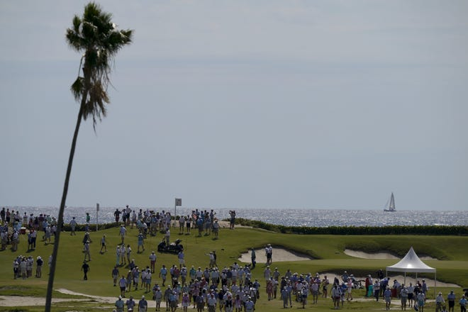 Fans watch on the 17th hole during Saturday's foursome matches during the Walker Cup at Seminole Golf Club in Juno Beach.