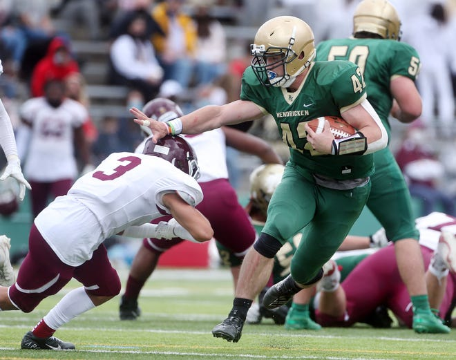 Bishop Hendricken's Brandyn Durand, right, gains yards in the first quarter as Corey Monterio of La Salle makes the stop.