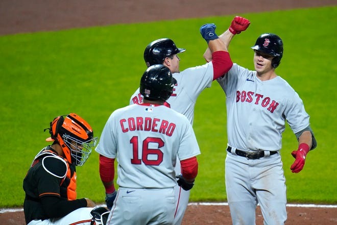 Red Sox first baseman Bobby Dalbec, right, is greeted at home plate by Hunter Renfroe and Franchy Cordero after he hit a three-run homer off Orioles pitcher Matt Harvey in the fourth inning in Friday night's game.