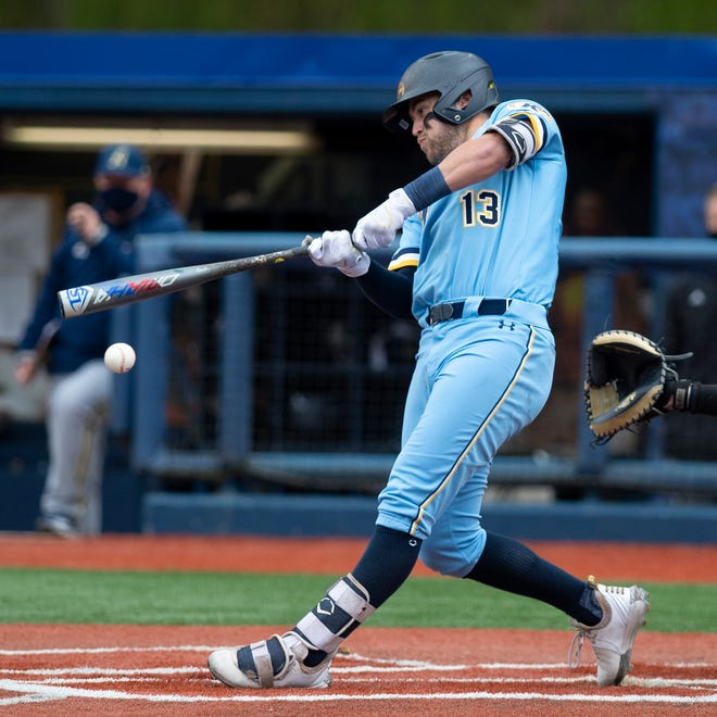Kent State junior centerfielder Collin Mathews takes a swing during Saturday's doubleheader against Akron at Schoonover Stadium.