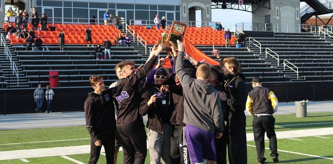 The Mount Union men's track and field team celebrate at 10th straight Ohio Athletic Conference championship.