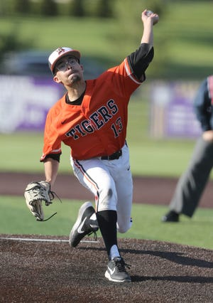 Massillon's Jaylen Leedy delivers a pitch against Jackson on Friday.