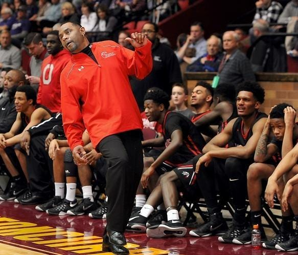 Rick Hairston reacts as he coaches the McKinley boys basketball team during the 2016 Division I district championship game at Memorial Civic Center. Hairston accepted an offer Saturday to become GlenOak's next boys basketball coach.