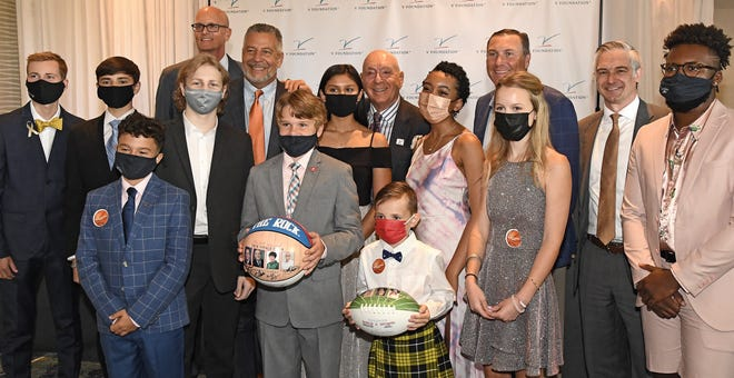 Lakewood Ranch resident and ESPN analyst Dick Vitale poses for a photo with attendees at Friday night's 16th Annual Dick Vitale Gala held at the Ritz-Carlton, Sarasota. This year's Gala raised more than $5 million for pediatric cancer research.