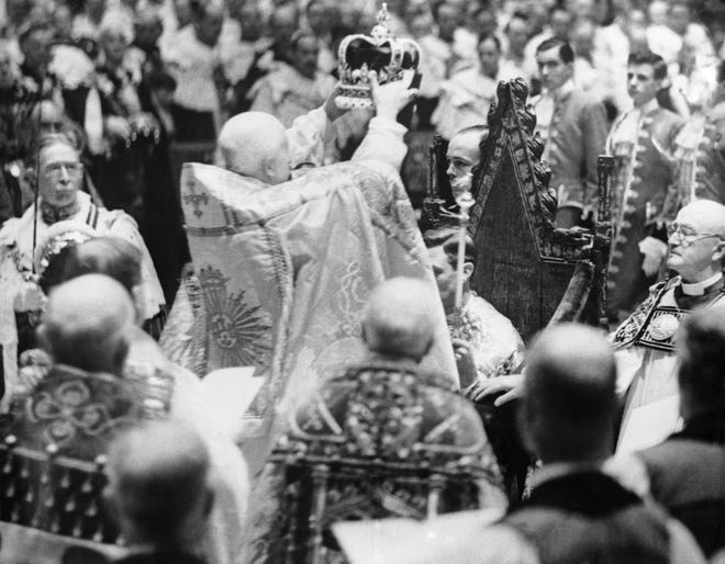 The actual moment as Britain's King George VI was crowned by the archbishop of Canterbury in Westminster Abbey, London, on May 12, 1937. This dramatic moment marked the climax of the historic ceremony.