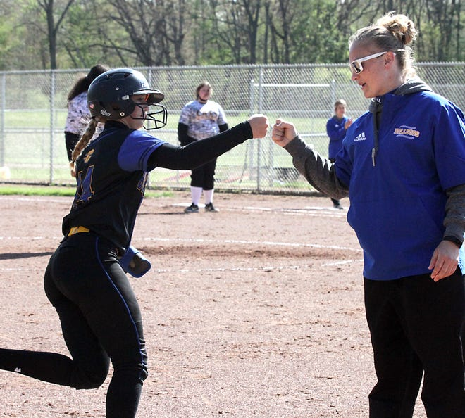 Kamryn Troyer fist-bumps head coach Jill Peterson after hitting her third home run of the game on Friday afternoon.