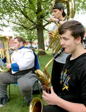 Michael Willison, a freshman at Centreville High School,on baritone sax, is joined by A.J. Schwartz, a senior, and James Holbrook, a junior, at a performance Friday on the lawn at the St. Joseph County Courthouse. The lunchtime show resumed of a tradition the high school started in the 1950s.
