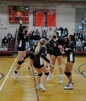 Old Rochester celebrates its win over Case in the South Coast Conference championship match.
