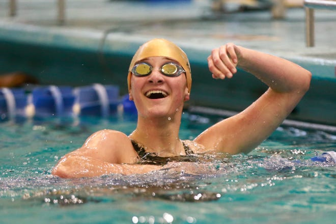 Taking another look at the scoreboard, Hayden's Audrey Kuta reacts to her first-place finish in the 100-yard freestyle at Friday's Topeka Girls City Championships at Capitol Federal Natatorium.