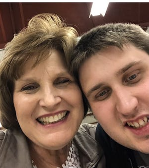 Diane Voss, left, and her son Shawn. Shawn Voss, who has autism, lives in a community-based setting in Hays.