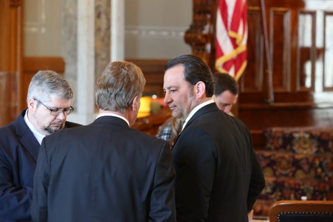 Members of the House Appropriations and Senate Ways and Means Committee confer on the House floor Thursday. The final piece of the state budget passed Friday evening.