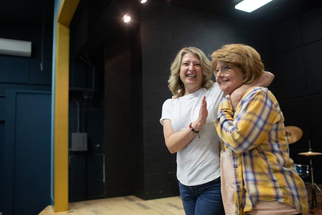 Goofing on the newly expanded stage inside the former Central Elementary School, Shannon Wittmer, left, Holton Community Theatre founder and creative director, and Carolyn McKee HCT board member, show off the progress they've made on their new space.