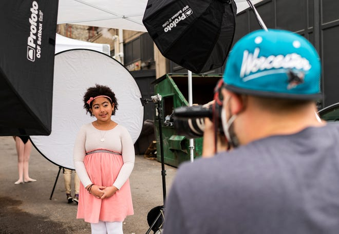"""Photographer Matt Wright shoots a portrait of Kasey Moore, 8, as part of the """"I Am Worcester"""" project Saturday at the Jean McDonough Arts Center."""