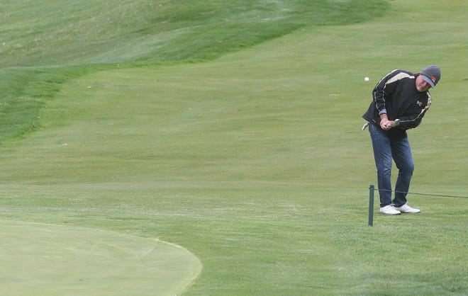 Mike Sweet chips in for a eagle 2 on the ninth hole at the Oak Shadows Golf Club's Re-Opening Outing Saturday.