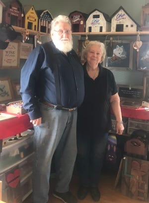 John and Carol Poland of Bluebird Embroidery.