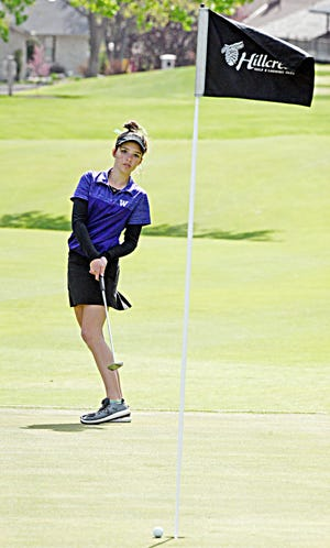 Watertown's Riley Zebroski reacts to just missing a putt on the No. 18 green during her round in the Yankton Invitational girls' golf tournament, Friday at Hillcrest Golf and Country Club.