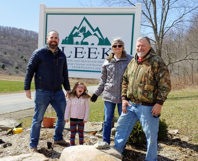 Left to right: Justin Lambert and Evelyn Lambert after presenting a check to Kate and Ed Fisher of the Leek Hunting and Mountain Preserve from proceeds of the Jason L. Dunham Memorial Golf Tournament.