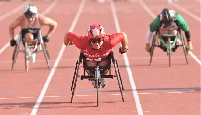 Coahoma's Vance Otto, center, races to a state title in the boys' 100 meters wheelchair event at the state track meet Friday at Mike A. Myers Stadium in Austin. He also won the 400, while finishing second in the shot put.