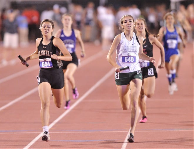 Haskell freshman Savanna Camacho, left, edges out a Harper runner for second in the Class 2A girls' 1,600 meter relay. It was Haskell's second silver and third medal in the three relays at the state track meet Friday in Austin.