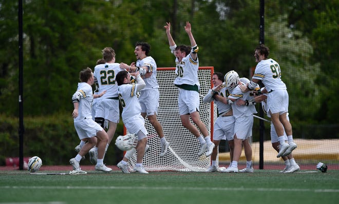 The University of Vermont men's lacrosse team celebrates after winning the America East championship game over Albany.