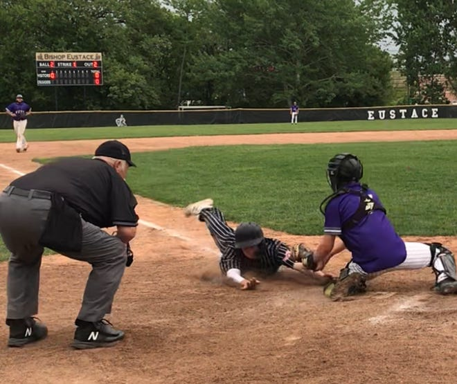 Bishop Eustace's Raffaele Rogers, center, is ruled safe by the umpire as he steals home in the bottom of the 10th inning as the Crusaders walked off with a 1-0 win over Cherry Hill West on Friday.