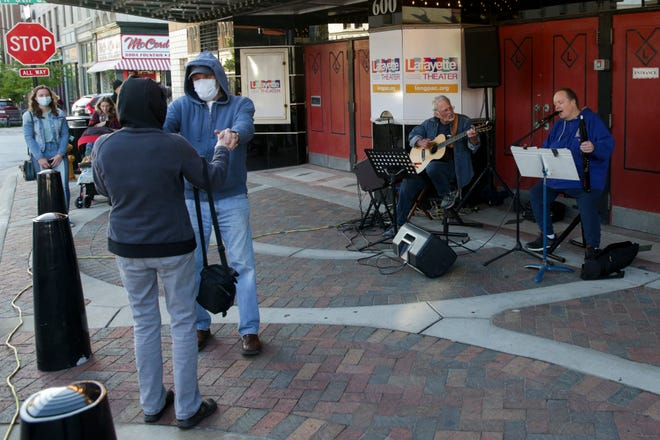 Rick Mummey performs outside the Lafayette Theater during a First Friday, Friday, May 7, 2021 in Lafayette.