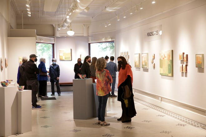 First Friday goers look around inside Artists' Own, Friday, May 7, 2021 in Lafayette.