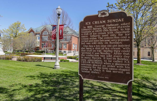 A historical marker, erected near Two Rivers city hall recalls the development of the Sundae in the city during the 1880s, Saturday, May 8, 2021, in Two Rivers, Wis.