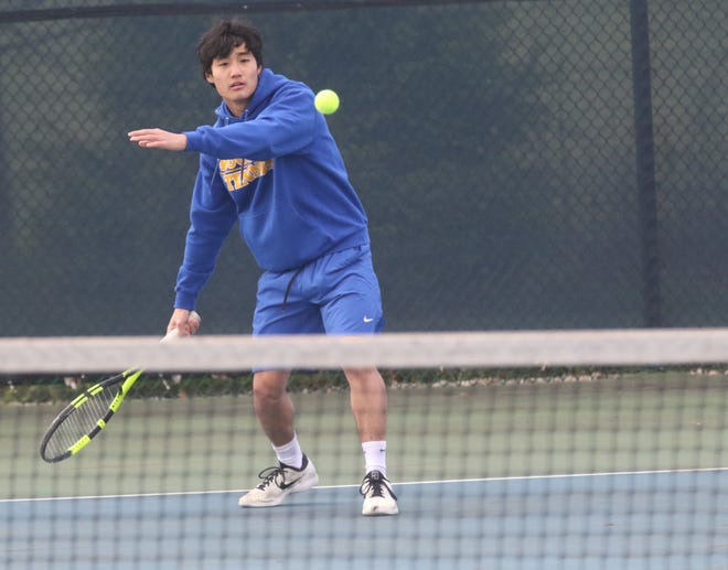 Wooster's Francis Sim returns a shot in the OCC Tournament. Sim finished runner-up at second singles.