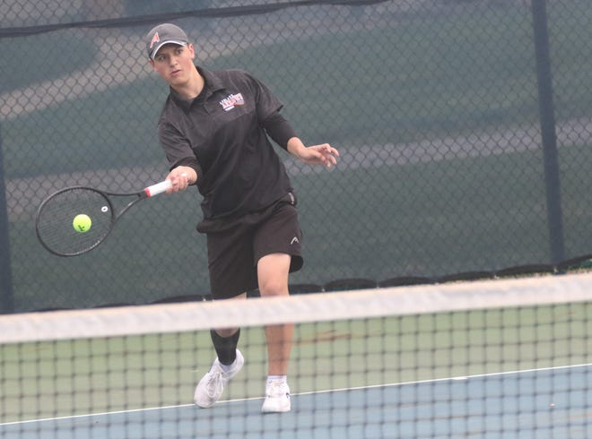 Ashland's Ryan Frazee returns a shot during a first singles match at the Ohio Cardinal Conference Championships Saturday at Mount Vernon Nazarene University.