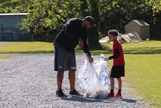 The Jones family picked up three bags of litter from the Historic Town Center near Veterans Park and the Pike Road Schools Historic Campus. Families, businesses, and other groups took part in the 2021 Pike Road Spring Cleanup, an annual beautification effort held in conjunction with the statewide Spring Cleanup presented by Alabama's People Against a Littered State (PALS).